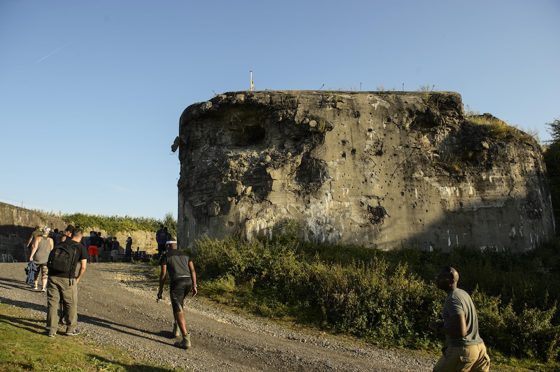 U.S. Air Force Airmen from the 52nd Logistics Readiness Squadron, Spangdahlem Air Base, Germany, walk up to Fort Aubin-Neufchateau, Belgium, Aug. 28, 2016. More than 25 Airmen worked to help preserve and excavate a World War II era bunker at the fort. (U.S. Air Force photo by Staff Sgt. Jonathan Snyder/Released)