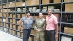 DLA Distribution Mapping at Fort Bragg employees, left to right, Marnetia Page, Army Staff Sgt. Monica Sotobenavides and Benedict Beason in Distribution's warehouse, which provides 10,000 square ft. of acclimatized, racked bay storage for mapping products.