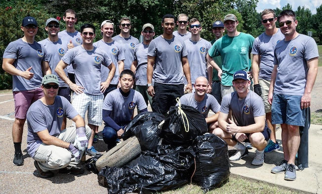 Specialized Undergraduate Pilot Training Class 17-13 volunteered to spend their weekend cleaning and picking up trash in downtown Columbus Aug 27 at the Riverwalk throughout and around the 4.2 mile walking trail. The class hopes to volunteer every few months with the local community. (Courtesy Photo)