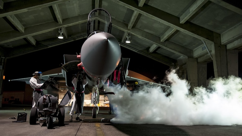 Airman Marquel Marshall and Airman 1st Class Darris Little, both 67th Aircraft Maintenance Unit F-15 Eagle crew chiefs, service a liquid oxygen converter on the flightline Aug. 24, 2016, at Kadena Air Base, Japan. Marshal and Little work as swing shift maintainers, ensuring around-the-clock mission readiness of Kadena AB's F-15s. (U.S. Air Force photo/Senior Airman Peter Reft)