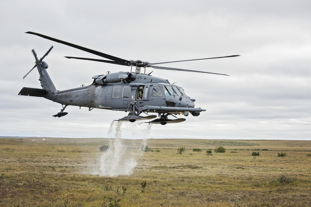 An HH-60 Pave Hawk helicopter from the 210th Rescue Squadron takes off after loading simulated casualties during exercise Arctic Chinook near Kotzebue, Alaska, Aug. 24, 2016. Arctic Chinook is a joint U.S. Coast Guard and U.S. Northern Command sponsored exercise, which focuses on multinational search and rescue readiness to respond to a mass rescue operation requirement in the Arctic. (U.S. Air National Guard photo/Staff Sgt. Edward Eagerton)
