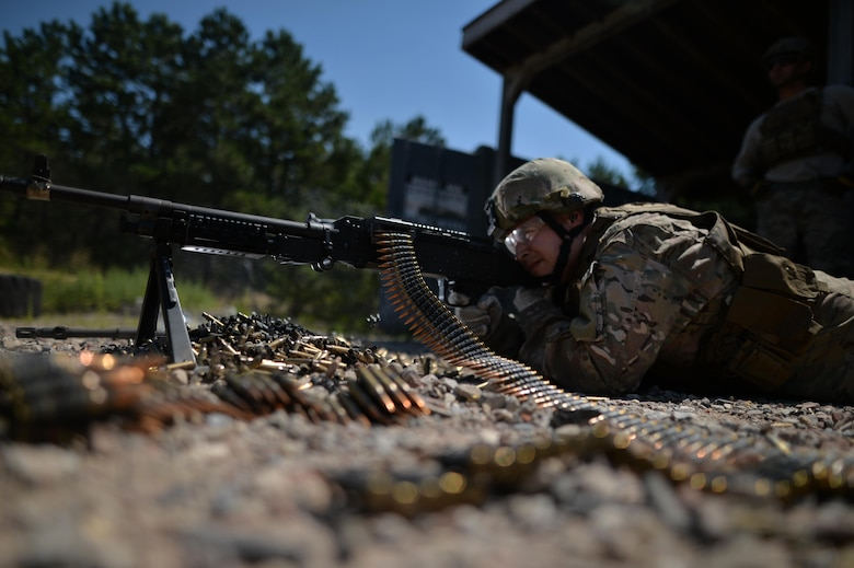 Staff Sgt. Robert Converse, a member of the 106th Rescue Wing Security Forces Squadron, fires a M240 machine gun during a training event at the Suffolk County Range in Westhampton Beach, N.Y., Aug. 24, 2016. Security forces members regularly train on the use and upkeep of these weapons, as well as the M249 squad automatic weapon, M4 carbine and M9 pistol. (U.S. Air National Guard photo/Staff Sgt. Christopher S. Muncy)