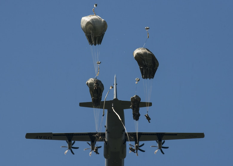 U.S. Army 173rd Airborne Brigade and German Army 1st Airborne Brigade paratroopers jump out of a C-130 Hercules near Aviano Air Base, Italy, Aug. 25, 2016. The C-130 was from the 86th Airlift Wing at Ramstein Air Base, Germany. (U.S. Air Force photo/Senior Airman Krystal Ardrey)