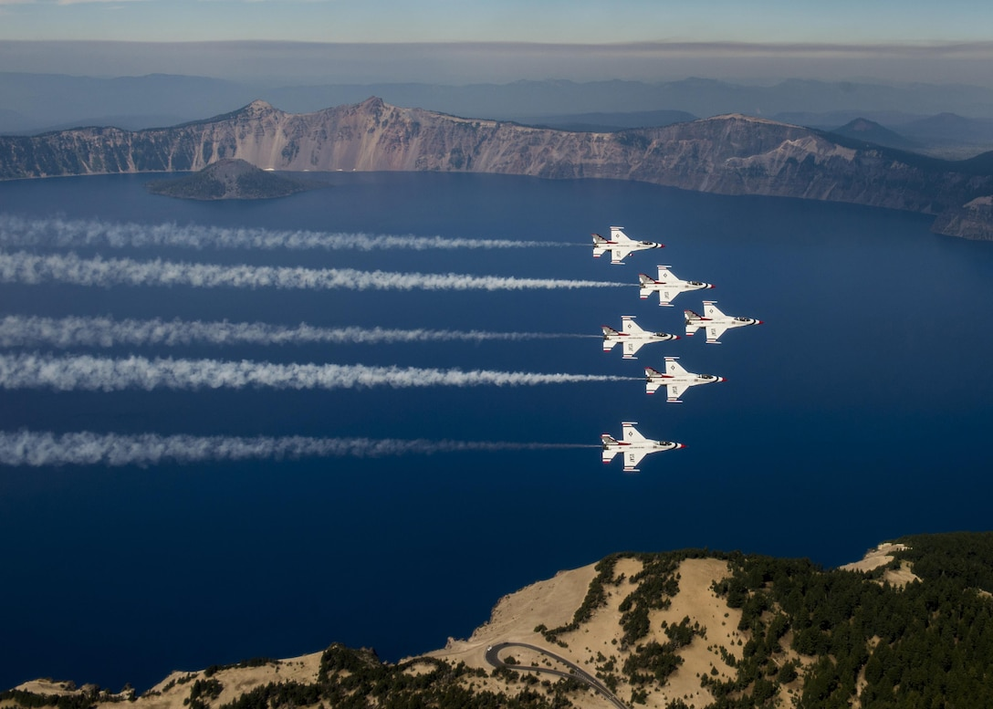 The Thunderbirds fly over Crater Lake, Oregon, during their return to Nellis Air Force Base, Nev., Aug. 29, 2016. The Thunderbirds performed at the Airshow and Warrior Expo at Joint Base Lewis-McChord, Wash., Aug. 27-28. (U.S. Air Force photo/Tech. Sgt. Christopher Boitz)