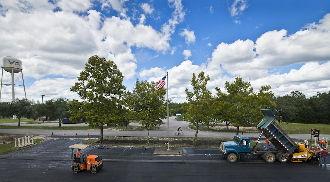 Asphalt paving is underway in front of the 919th Special Operations Wing's Haugen Headquarters building Aug. 31 at Duke Field, Fla.  (U.S. Air Force photo/Tech. Sgt. Sam King)