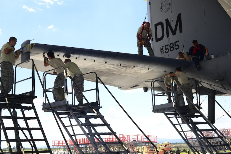 U.S. Airmen from the 755th Aircraft Maintenance Squadron work together to remove the panel on the right horizontal stabilizer of an EC-130H Compass Call at Davis-Monthan Air Force Base, Ariz., Aug. 30, 2016. The 755th AMXS plans and executes all equipment maintenance actions for 14 Compass Call aircraft. (U.S. Air Force photo by Senior Airman Betty R. Chevalier)