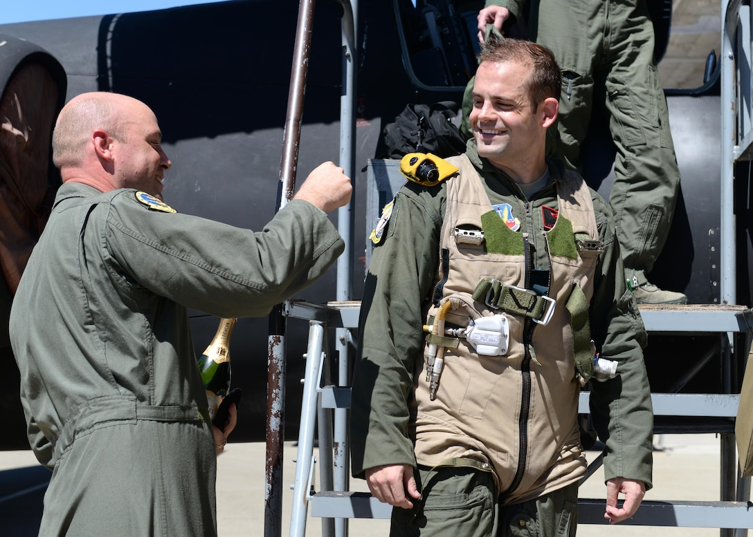 Lt. Col. Paul Wurster (left), 1st Reconnaissance Squadron commander, places Maj. J.J.'s, 1st RS student pilot, U-2 Dragon Lady patch after qualifying as the 1,000 pilot to operate the U-2 Aug. 31, 2016, at Beale Air Force Base, California. To have the opportunity to fly a U-2, the applicant must be a pilot in the U.S. Armed Forces, have obtained 1200 rated flight hours or other variables depending on aircraft flown, 12 months or 400 hours as pilot in command, and have gone through the application process. (U.S. Air Force photo by Senior Airman Ramon A. Adelan)