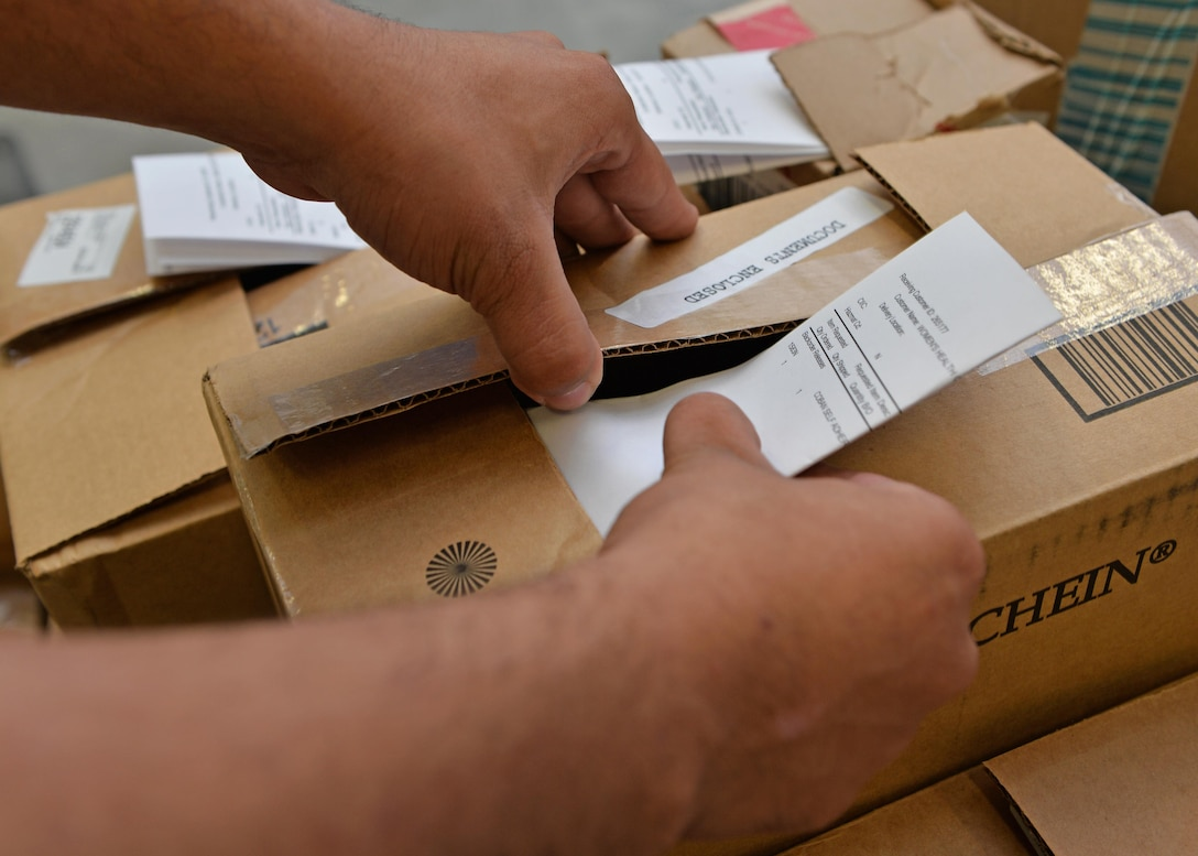 Senior Airman Christopher Lomax, a medical logistics journeyman assigned to the 1st Special Operations Medical Support Squadron, places a delivery list inside a package at Hurlburt Field, Fla., Aug. 30, 2016. The list travels with the package to ensure the delivery is recorded as arriving at the appropriate location. These packages contain medical provisions such as medications, supplies and equipment needed to sustain the force. (U.S. Air Force photo by Senior Airman Andrea Posey)