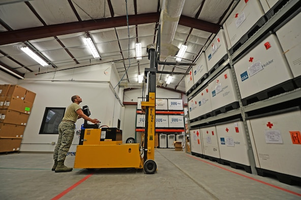 Senior Airman Christopher Lomax, a medical logistics journeyman from the 1st Special Operations Medical Support Squadron, uses a forklift to reach supplies on a tri-wall at Hurlburt Field Fla., Aug. 30, 2016. A tri-wall holds supplies that are sent to deployed troops if biological, nuclear or radiological emergencies occur. (U.S. Air Force photo by Senior Airman Andrea Posey)