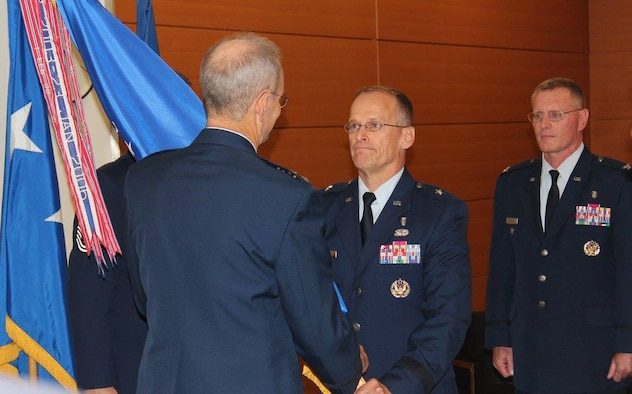 Lt. Gen. (Dr.) Mark Ediger, the Air Force Surgeon General, passed command of the Air Force Medical Support Agency to Col. Dean Borsos during a change of command ceremony Aug. 30 at the Defense Health Headquarters in Falls Church, Va. Borsos assumed command of AFMSA from Brig. Gen. James McClain.