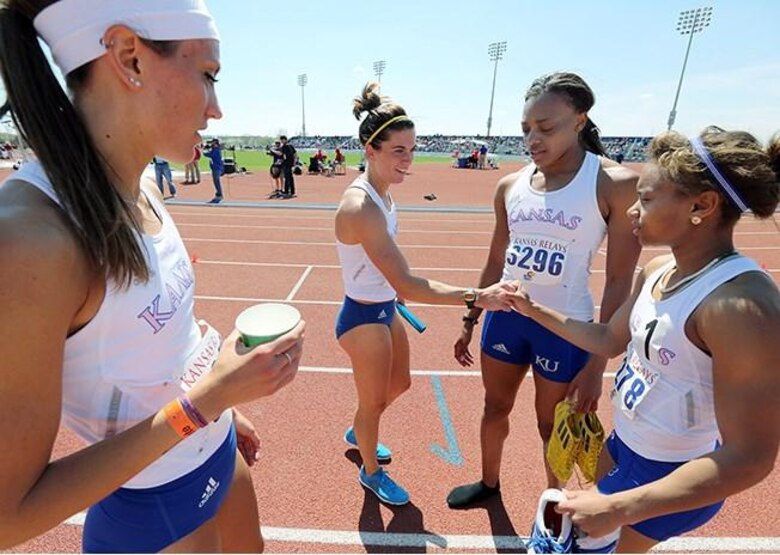 Second Lieutenant Rhavean Anderson (pictured second from the right), alongside her teammates, competed in the women's distance medley at Rock Chalk Park in Lawrence, Kansas, on April 2014. The team went on to win and break a record with a time of 11 minutes 31 seconds and 21 nanoseconds. (Photo courtesy of 2nd Lt. Rhavean Anderson/Released)