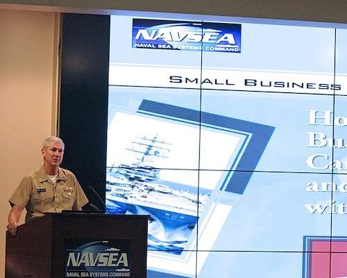 Vice Admiral Thomas Moore, Commander, NAVSEA provides a brief welcome and introduction at the start of the Small Business Industry Day in the Humphreys Auditorium, Naval Sea Systems Command headquarters.
