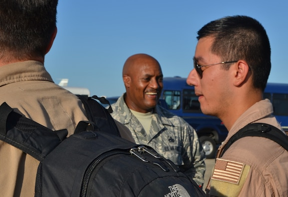 Chief Master Sgt. Avery Woolridge, 552nd Air Control Wing command chief master sergeant, welcomes returning members of the 960th Airborne Air Control Squadron and 552nd Maintenance Group from a July 19 deployment to Southwest Asia. Chief Woolridge is retiring with 30 years of service. His retirement ceremony will take place Sept. 9 at 10 a.m. in Dock 2 of Hangar 230. (Air Force photo by Ron Mullan)
