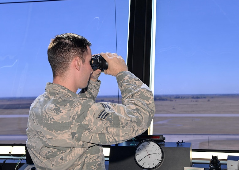 Senior Airman Joseph Shine, 9th Operations Support Squadron air traffic controller, watches an aircraft land Aug. 31, 2016, at Beale Air Force Base, California. The Beale air traffic control tower won the Air Force's 2015 air traffic control tower of the year. (U.S Air Force photo by Airman Tristan D. Viglianco)