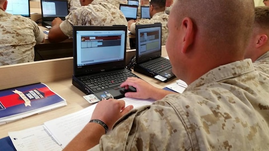 Marines from Basic Recruiter Course learning the Components of Systematic Recruiting.