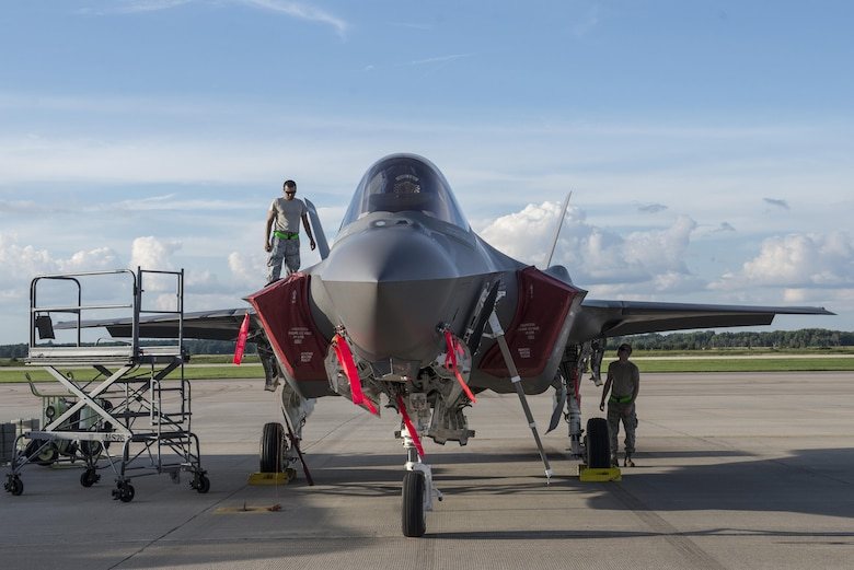 33rd Aircraft Maintenance Squadron Airmen perform a maintenance inspection on an F-35A during Exercise Northern Lightning Aug. 30, 2016, at Volk Field, Wis. Northern Lightning is a joint total force exercise between the Air National Guard, Air Force and Navy conducting offensive counter air, suppression and destruction of enemy air defense and close air support. (U.S. Air Force photo by Senior Airman Stormy Archer)
