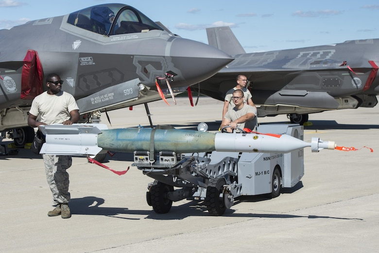 58th Aircraft Maintenance Unit weapons load crew members unload a GBU-12 from an F-35A during exercise Northern Lightning Aug. 31, 2016, at Volk Field, Wis. During the exercise, 33rd FW pilots were able to execute offensive counter air, suppression of enemy air defenses, destruction of enemy air defenses, and the employ GPS-guided munitions  for close air support. (U.S. Air Force photo by Senior Airman Stormy Archer)