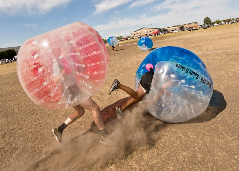 A Team Minot Airman falls while playing knockerball during the Summer Games at Minot Air Force Base, N.D., Aug. 30, 2016. In knockerball, a variation of soccer, participants wear large inflatable bubbles around their upper body that allows them to bounce off other players, and makes falling down a bit more fun. (U.S. Air Force photo/Airman 1st Class J.T. Armstrong)