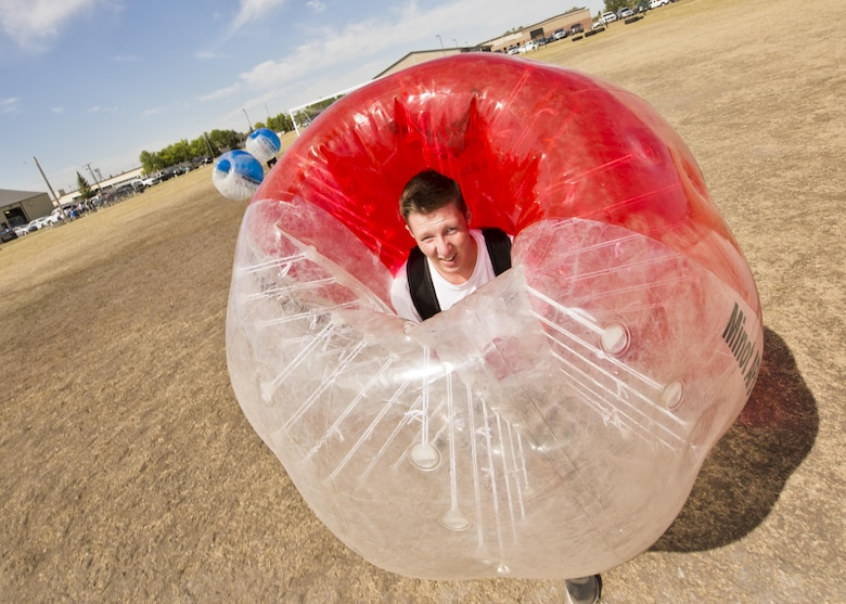 Airman 1st Class Christian Sullivan, 5th Bomb Wing Public Affairs photojournalist, pauses for a photo while playing knockerball during the Summer Games at Minot Air Force Base, N.D., Aug. 30, 2016. The Summer Games hosted new events included knockerball, build a boat and 4x200m freestyle relay. (U.S. Air Force photo/Airman 1st Class J.T. Armstrong)