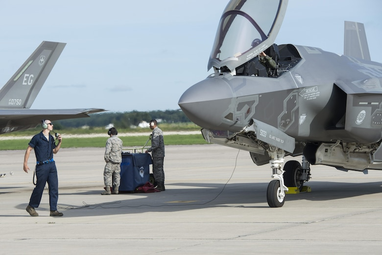 Airman 1st Class Derek Leuzinger, 33rd Aircraft Maintenance Squadron assistant dedicated crew chief, prepares to launch an F-35A during exercise Northern Lightning Aug. 26, 2016, at Volk Field, Wis. Northern Lightning is a joint total force exercise between the Air National Guard, Air Force and Navy conducting offensive counter air, suppression and destruction of enemy air defense and close air support. (U.S. Air Force photo by Senior Airman Stormy Archer)