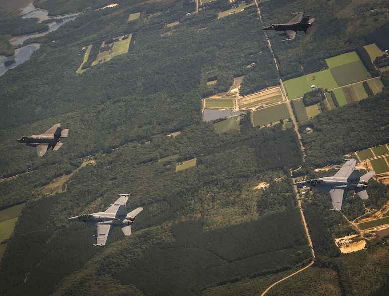 A U.S. Air Force F-35A Lighting II, F-16C Fighting Falcon and a U.S. Navy F/A-18F Super Hornet fly in formation during Exercise Northern Lighting Aug. 31, 2016. Northern Lightning is a tactical-level, joint training exercise that emphasizes fifth and fourth generation assets engaged in a contested, degraded environment. (U.S. Air Force photo/Staff Sgt. DeAndre Curtiss)