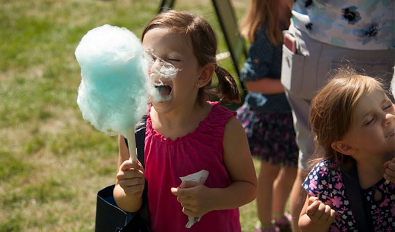 Emily Liapis partakes of some freshly made cotton candy during the Food Truck Festival, Aug. 26, 2016, at Fairchild Air Force Base, Wash. The Food Truck Festival offered many treats and games for children big and small.  (U.S. Air Force photo/Airman 1st Class Ryan Lackey)