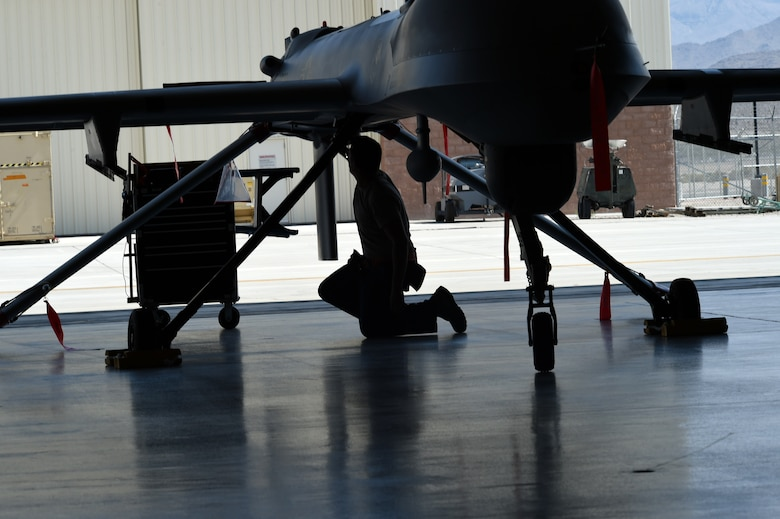 A 432nd Aircraft Maintenance Squadron, Tiger Aircraft Maintenance Unit maintainer inspects an MQ-1 Predator Aug. 24, 2016, at Creech Air Force Base, Nevada. Tiger Aircraft Maintenance Unit has started the transition to the larger, more capable MQ-9 Reaper.  (U.S. Air force photo by Airman 1st Class James Thompson)