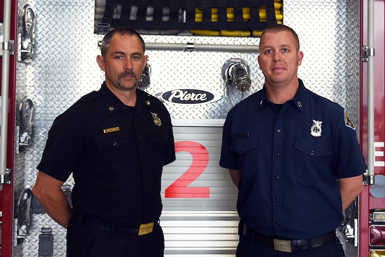 Mark Smith, 30th Civil Engineer Squadron assistant chief of operations, and Robert Raffel, 30th CES rescue truck captain, Sept. 1, 2016, Vandenberg Air Force Base, Calif. Smith and Raffel, won DoD civilian fire officer of the year and DoD civilian firefighter of the year, respectively. (U.S. Air Force photo by Senior Airman Ian Dudley/Released)