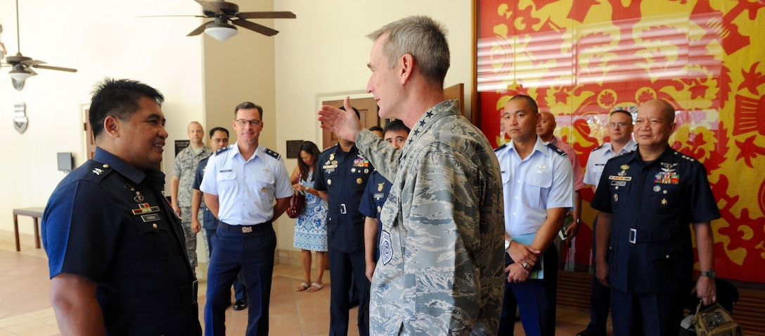 Gen. Terrence J. O'Shaughnessy, Pacific Air Forces commander, right, and Maj. Gen. Conrado V. Parra, Jr., Philippine Air Force vice commander, greet each other during the fifth annual U.S. and Philippine Airman-to-Airman (A2A) Talks at Joint Base Pearl Harbor-Hickam, Hawaii, Aug. 29, 2016.  The three-day A2A talks between Pacific Air Forces and the Philippine Air Force is a forum to plan and discuss future operations, activities and actions (OAA) and strengthen the AF-AF relationship.  The talks are air forces specific enabling dialogue for regional security cooperation in air operations. (U.S. Air Force photo by Staff Sgt. Alexander Martinez)