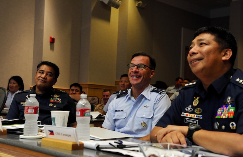 Maj. Gen. Conrado V. Parra, Jr., Philippine Air Force vice commander, left, Maj. Gen. Mark Dillon, center, Pacific Air Forces vice commander and Col. Fermin M. Carangan, Philippine Air Force assistant chief of air staff for operations, participate in briefings  during the fifth annual U.S. and Philippine Airman-to-Airman Talks at Joint Base Pearl Harbor-Hickam, Hawaii, Aug. 30, 2016.  The goals of the three-day conference were synchronizing planning between the U.S. Air Force and Philippine Air Force, shaping engagement priorities, strengthening the bilateral relationship with the PAF and focusing on a 3 to 5 year outlook for PACAF-PAF activities. (U.S. Air Force photo by Staff Sgt. Kamaile O. Chan)