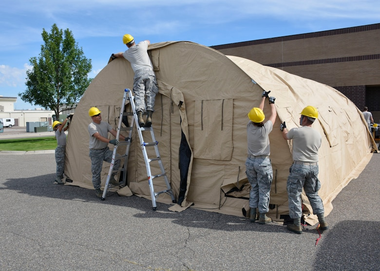 Members of the 120th Sustainment Services Flight construct an Alaska Small Shelter System during the guard drill at the 120th Airlift Wing in Great Falls, Mont. Aug. 13, 2016. (U.S. Air National Guard photo by Senior Master Sgt. Eric Peterson)
