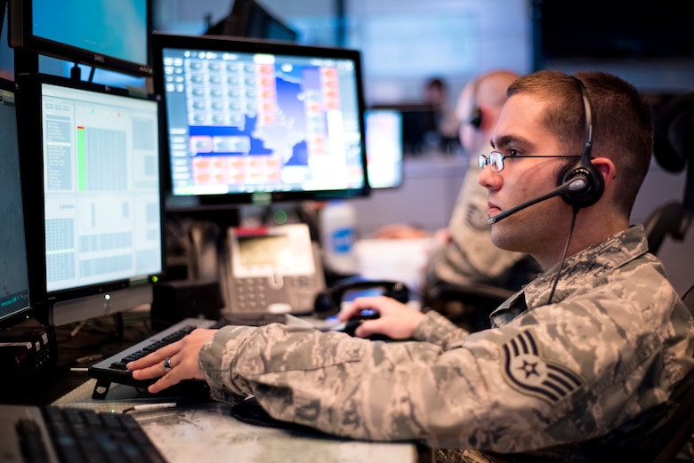 Staff Sgt. Micah McDonald, a air surveillance technician with the 176th Air Defense Squadron, Alaska Air National Guard, evaluates radar data during exercise Fencing Rice on JBER, June 14, 2016. Fencing Rice is a local exercise designed to test the unit's Air Defense response. The 176 ADS employs surveillance, identification, weapons control and data links in support of the Alaskan NORAD region's 24/7/365 mission to watch and protect the skies over 1.3 million square miles of Alaskan airspace. (U.S. Air National Guard photo by Staff Sgt. Edward Eagerton/released)