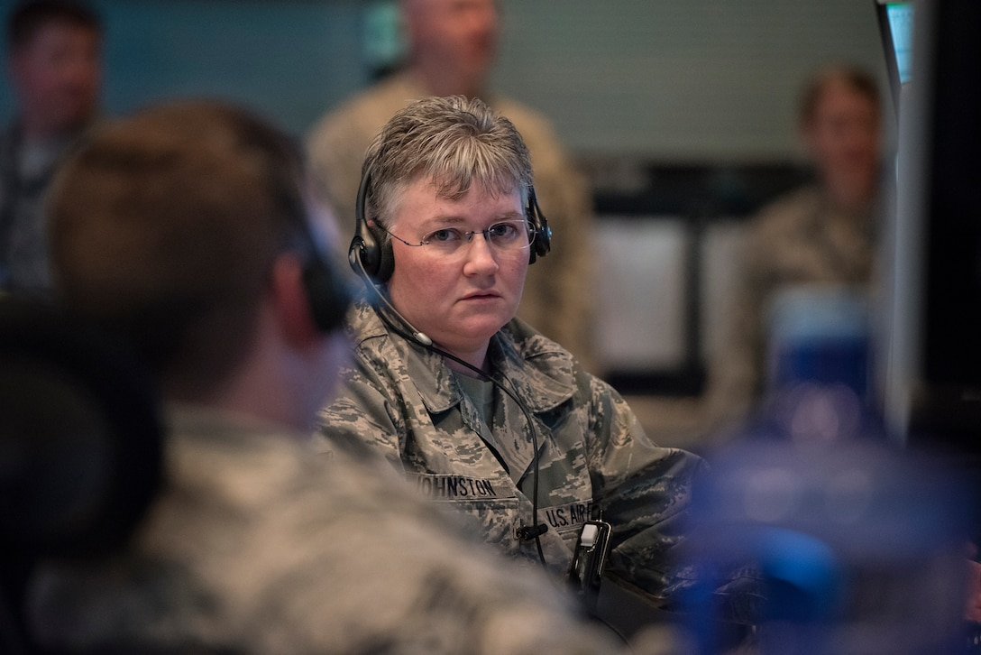Tech. Sgt. Jennifer Johnston, an identification technician with the 176th Air Defense Squadron, Alaska Air National Guard, participates in exercise Fencing Rice on JBER, June 14, 2016. Fencing Rice is a local exercise designed to test the unit's Air Defense response. The 176 ADS employs surveillance, identification, weapons control and data links in support of the Alaskan NORAD region's 24/7/365 mission to watch and protect the skies over 1.3 million square miles of Alaskan airspace. (U.S. Air National Guard photo by Staff Sgt. Edward Eagerton/released)