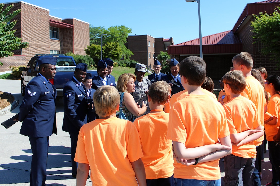 Tammie Smeltzer, Professional Continuing Education manager for the I.G. Brown Training and Education Center, speaks to kids in summer camp with the University of Tennessee's Junior Leadership Institute during a visit at the TEC, June 29, 2016, on McGhee Tyson Air National Guard Base in Louisville, Tenn. (Photo courtesy University of Tennessee)