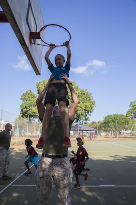 U.S. Marine Corps Cpl. Cody Braunscheidel, an aviation logistics information management systems specialist assigned to Marine Fighter Attack Squadron (VMFA) 122, lifts a student up at MacFarlane Primary School in Katherine, Northern Territory, Australia, Sept.1, 2016. Marines are invited to the school every iteration of Southern Frontier, a three week unit level training conducted by U.S. Marines at Royal Australian Air Force Base Tindal, to mentor, teach, and be role models to the students. MacFarlane Primary School also gives the students a consolidated education in literacy, numeracy, respect and behavior management. (U.S. Marine Corps photo by Cpl. Nicole Zurbrugg)