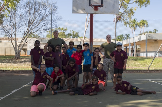 U.S. Marine Corps Cpl. Cody Braunscheidel, left, an aviation logistics information management systems specialist, and Cpl. Landis Lied, right, an embarkation and logistics specialist assigned to Marine Fighter Attack Squadron (VMFA) 122, pose with students from MacFarlane Primary School in Katherine, Northern Territory, Australia, Sept. 1, 2016. Marines are invited to mentor, teach and serve as role models to the students every iteration of Southern Frontier, a three week unit level training conducted by U.S. Marines at Royal Australian Air Force Base Tindal. With a population of 92 percent indigenous students, the school provides a structured educational environment to the students. (U.S. Marine Corps photo by Cpl. Nicole Zurbrugg)