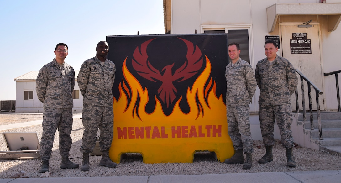 The four Airmen of the 379th Expeditionary Medical Operations Squadron mental health clinic from left to right,  Staff Sgt. Nickolas Widtfeldt, mental health technician, Capt. Tyrone Simon, social worker,  Capt.  (Dr.) Ryan Dumke, psycholigist, Technical Sgt. Anthony Chavez, mental health technician, assemble for a team photo  Aug. 26, 2016, at Al Udeid Air Base, Qatar. (U.S. Air Force photo/Tech. Sgt. Carlos J. Trevino/Released)