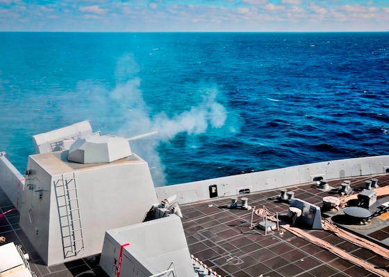 "ATLANTIC OCEAN – The amphibious transport dock ship USS New York (LPD 21) fires its MK46 30mm gun during a live-fire exercise. Navy scientists and engineers evaluated a strike group's Aegis combat system and gun weapon systems – including the 30 millimeter gun – as well as unmanned vehicles integrated with surface and air assets at the 2016 USS Dahlgren demonstration, Aug. 30. The test – made possible by a cybernetic laboratory called USS Dahlgren – proved engagement coordination across the simulated battlegroup and live fire destruction of multiple targets from two combatants utilizing two different gun based systems. ""This has been five to six years in the making and couldn't come at a better time as we see real-world events such as the recent small boat incursions in the Middle East, highlighting the need for the Fleet,"" said Capt. Brian Durant, NSWCDD commanding officer. (U.S. Navy photo by Mass Communication Specialist 2nd Class Cyrus Roson/Released)"