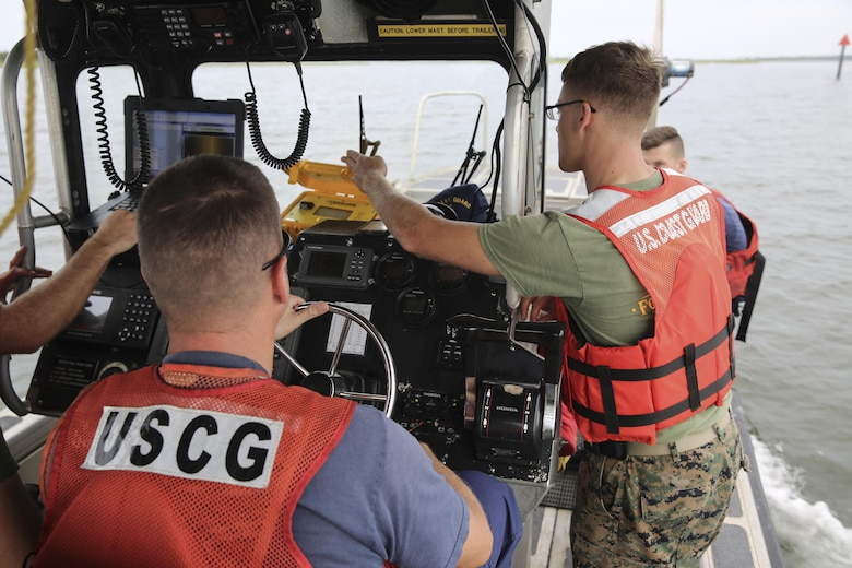 U.S. Marines with Battlefield Surveillance Company, 2nd Intelligence Battalion, regain Global Positioning System signal while boating through a channel off the coast of Oak Island, N.C., Aug. 31, 2016. The Marines teamed up with Coast Guardsmen at USCG Station Oak Island, N.C., to create a topographical layout of waterways that were previously unidentifiable. The new maps will correct navigation discrepancies such as off-station buoys or extinguished lights. (U.S. Marine Corps photo by Cpl. Kaitlyn V. Klein)