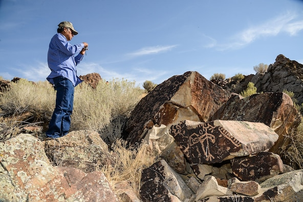 Rupert Steele of the Confederated Tribes of the Goshute Reservation takes a photo during a tour of a petroglyph site in Box Elder County, Utah, Aug. 26, 2016. The tour was part of the 2016 Annual American Indian Meeting, an event which provides a face-to-face forum for tribal leaders and federal agencies to discuss tribal concerns on federally managed land. (U.S. Air Force photo by R. Nial Bradshaw)