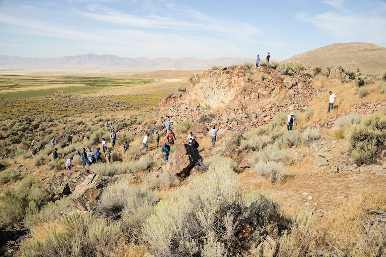 Attendees of the 2016 Annual American Indian Meeting climb a hillside in Box Elder County, Utah, during a guided tour of a petroglyph site, Aug. 26, 2016. (U.S. Air Force photo by R. Nial Bradshaw)