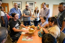 Jason Brough explains the process of making chokecherry porridge to attendees of the 2016 Annual American Indian Meeting at the Bear River Migratory Bird Refuge, Brigham City, Utah, Aug. 26, 2016. (U.S. Air Force photo by R. Nial Bradshaw)