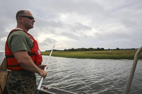 Staff Sgt. Daniel Weybright, a geographic intelligence specialist with Battlefield Surveillance Company, 2nd Intelligence Battalion, prepares to test the depth of the water off the coast of Oak Island, N.C., Aug. 31, 2016. U.S. Marines with the battalion teamed up with U.S. Coast Guardsmen at USCG Station Oak Island, N.C., to create a topographical layout of waterways that were previously unidentifiable. The new maps will correct navigation discrepancies such as off-station buoys or extinguished lights. (U.S. Marine Corps photo by Cpl. Kaitlyn V. Klein)