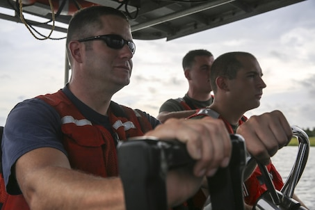 U.S. Marines with Battlefield Surveillance Company, 2nd Intelligence Battalion, and U.S. Coast Guardsmen boat through channels and survey the water off the coast of Oak Island, N.C., Aug. 31, 2016. The Marines teamed up with the Coast Guardsmen at USCG Station Oak Island, N.C., to create a topographical layout of waterways that were previously unidentifiable. The new maps will correct navigation discrepancies such as off-station buoys or extinguished lights. (U.S. Marine Corps photo by Cpl. Kaitlyn V. Klein)