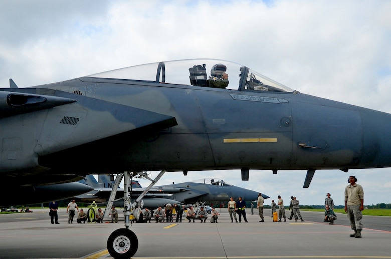 U.S. Air Force Airmen assigned to the 194th Expeditionary Fighter Squadron and the 493rd Fighter Squadron, see-off F-15C Eagle pilots assigned to the 194th EFS after completing a multilateral flying training deployment at Ämari Air Base, Estonia, Aug. 26, 2016. Aircraft and personnel from the U.S., Sweden, Finland, the U.K. and Estonia participated in flying training exercises to build interoperability and focus on dissimilar air training. (U.S. Air Force photo by Senior Airman Erin Trower/Released)