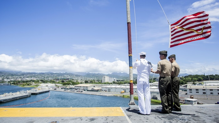 U.S. Marines and Sailors with the 13th Marine Expeditionary Unit and Boxer Amphibious Ready Group moore raise the colors aboard the USS Boxer, Joint Base Pearl Harbor-Hickman Pier, Hawaii, Aug. 29, 2016. The 13th MEU, embarked on the Boxer Amphibious Ready Group, is operating in the U.S. 3rd Fleet area of operations in support of security and stability in the Pacific region.