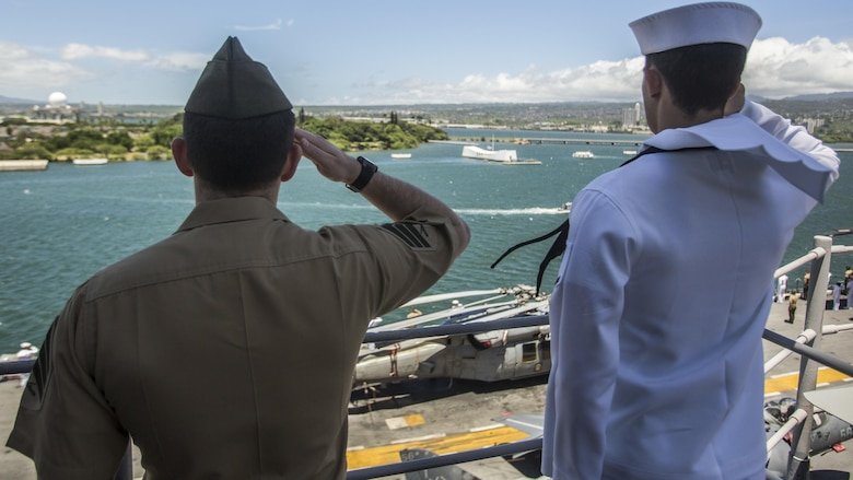 U.S. Marines and Sailors with the 13th Marine Expeditionary Unit and Boxer Amphibious Ready Group salute the USS Arizona memorial while aboard the USS Boxer, Joint Base Pearl Harbor-Hickman Pier, Hawaii, August 29, 2016. The 13th MEU, embarked on the Boxer Amphibious Ready Group, is operating in the U.S. 3rd Fleet area of operations in support of security and stability in the Pacific region.