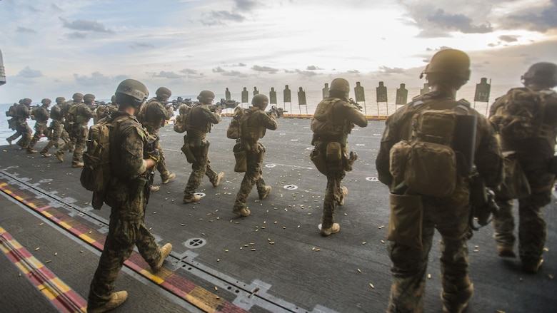 U.S. Marines with the 13th Marine Expeditionary Unit's Maritime Raid Force conduct a moving drill during a live-fire range aboard the USS Boxer (LHD 4), July 29, 2016. The 13th MEU is conducting sustainment training to maintain proficiency and combat readiness while deployed with the Boxer Amphibious Ready Group during Western Pacific Deployment 16-1.