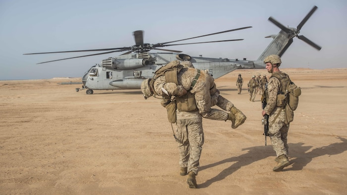 U.S. Marines with the 13th Marine Expeditionary Unit conduct a casualty collection drill during sustainment training in the 5th Fleet area of operations, June 18, 2016. The 13th MEU is conducting sustainment training to maintain proficiency and combat readiness while deployed with the Boxer Amphibious Ready Group during Western Pacific Deployment 16-1.