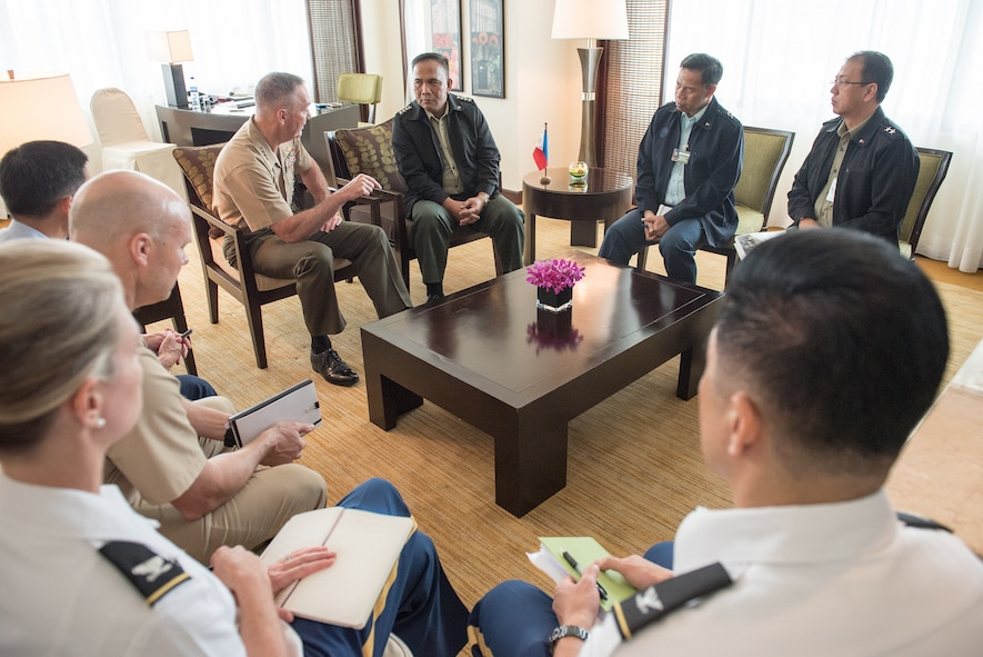 Marine Corps Gen. Joe Dunford speaks with Philippine Armed Forces Chief of Staff Gen. Ricardo Visaya